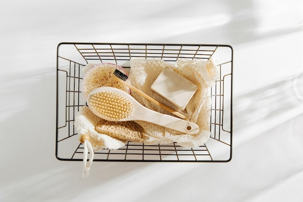 Eco natural bathroom accessories, natural cosmetics products and tools in black metal basket. zero waste concept. plastic free. flat lay, top view
