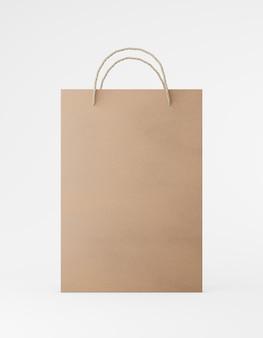 エコ包装のモックアップバッグクラフト紙、ハンドル前面。白い背景のプロモーション広告の標準的な中程度の茶色のテンプレート。 3dレンダリング