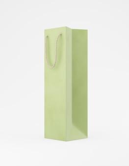 エコ包装モックアップバッグクラフト紙のハンドルの半分の側面。白い背景の宣伝広告に背の高い狭い緑のテンプレート。 3dレンダリング
