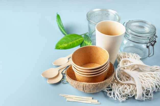 Eco tableware. paper and bamboo cups, bag and wooden cutlery.
