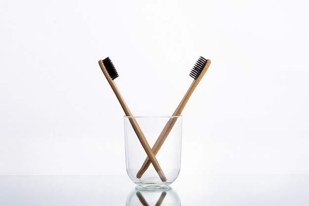 Eco toothbrushes made of wood in a glass glass