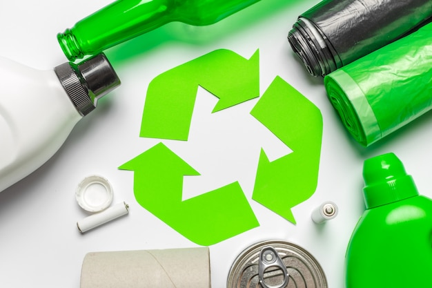 Eco  with recycling symbol on table background top view