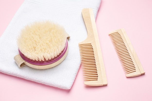 Eco wooden toothbrush, comb and brush for dry massage on pink