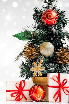 Ecofriendly artificial christmas tree with gifts on white background new year concept