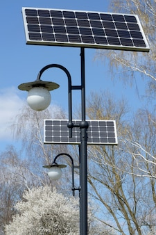 Ecofriendly  solar panels powered street lamp in the park