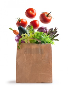 Ecological bag of vegetables isolated from the wall