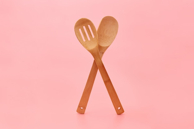 Ecological wooden cutlery on pink