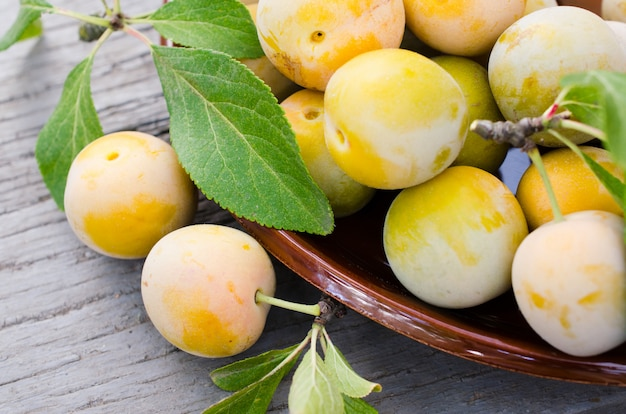 Ecologically grown yellow plums in a bowl