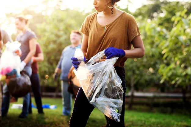 Ecology group of people cleaning the park