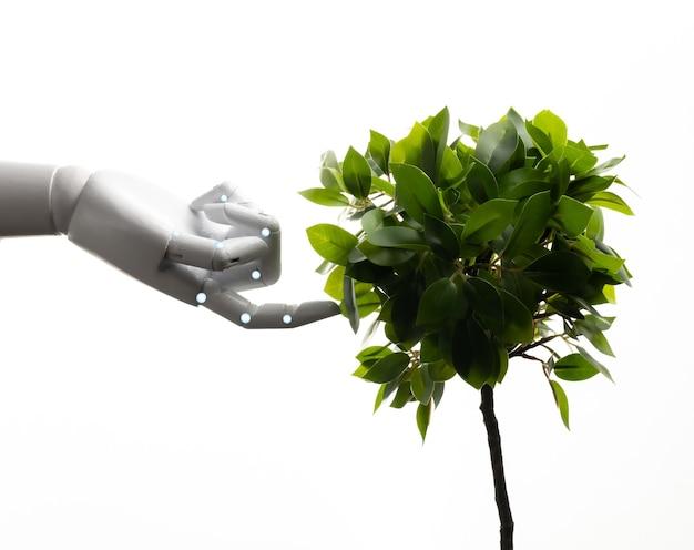 Концепция технологии экологии с роботизированной рукой с зелеными листьями, изолированными на белом