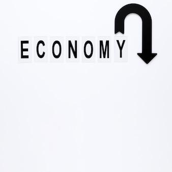Freccia di economia con copia-spazio