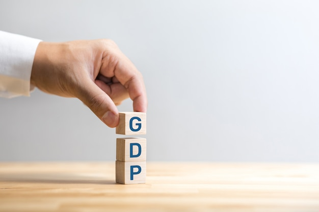 Economy concepts with gdp on wood
