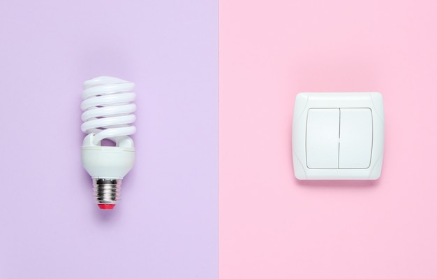 Economy light bulb, switch. top view. minimalism electro consumer concept