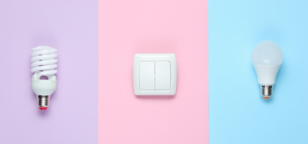 Economy light bulbs, the switch. top view. minimalism electro consumer concept