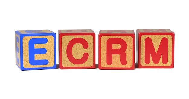 Ecrm on colored wooden childrens alphabet block isolated on white.