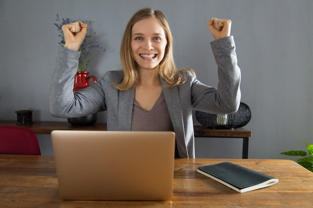 Ecstatic businesswoman making yes gesture