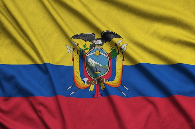 Ecuador flag  is depicted on a sports cloth fabric with many folds.