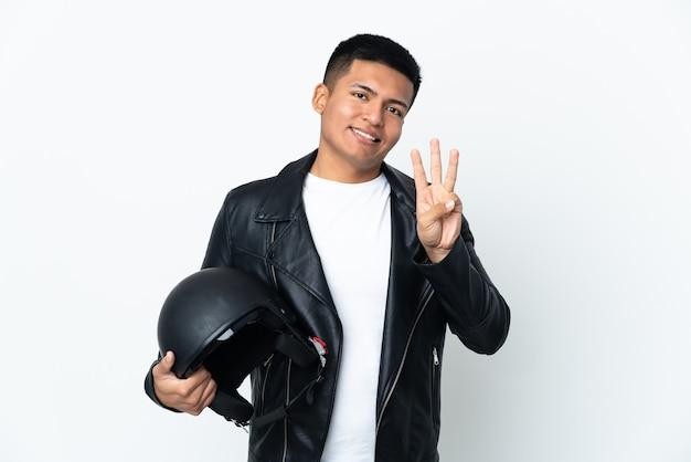 흰색 배경에 행복하고 손가락으로 세 세에 고립 된 오토바이 헬멧 에콰도르 사람