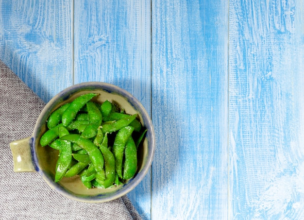 Edamame nibbles in a cup