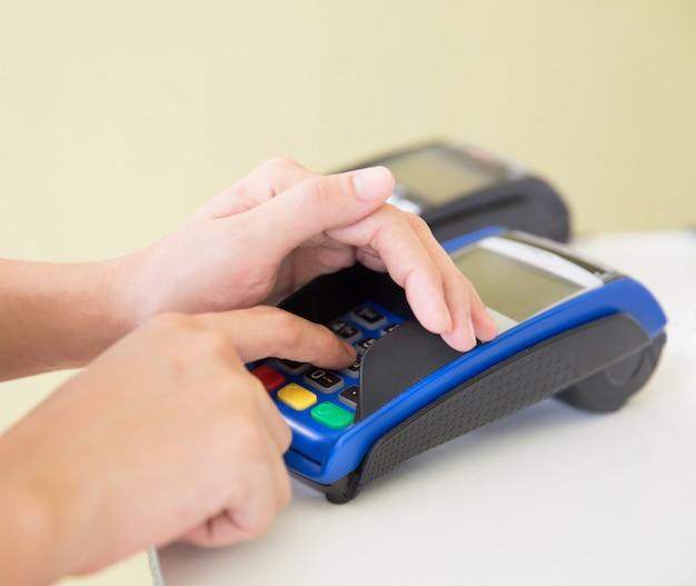Edc ( electronic data capture) machine hand pressing password on terminal