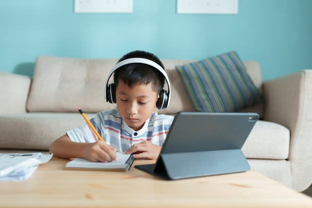 Education. asian boy learning and doing homework