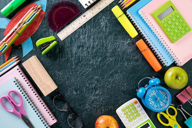 Education or back to school on chalkboard background. flat lay.