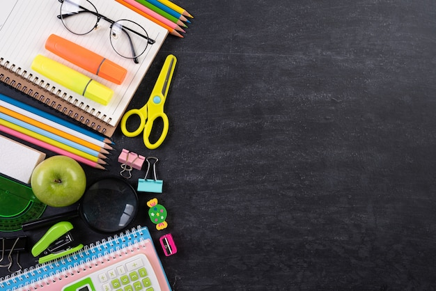 Education or back to school concept on chalkboard background. flat lay.