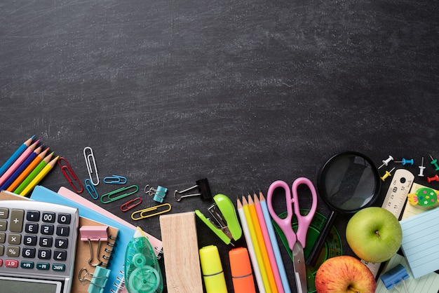 Education or back to school concept on chalkboard. flat lay.