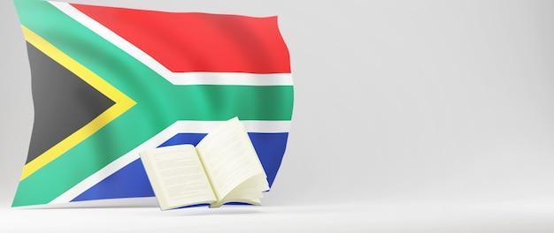教育の概念。本と白い背景の上の南アフリカの旗の3d。