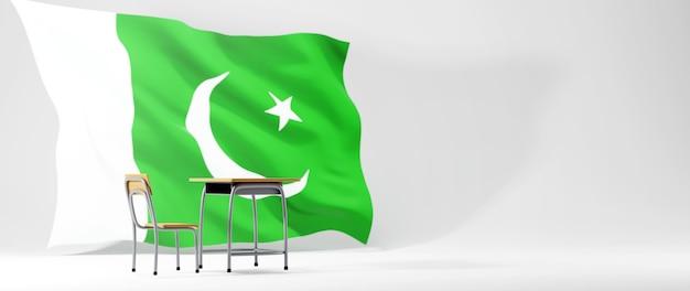 教育の概念。白い背景の上の机とパキスタンの旗の3d。