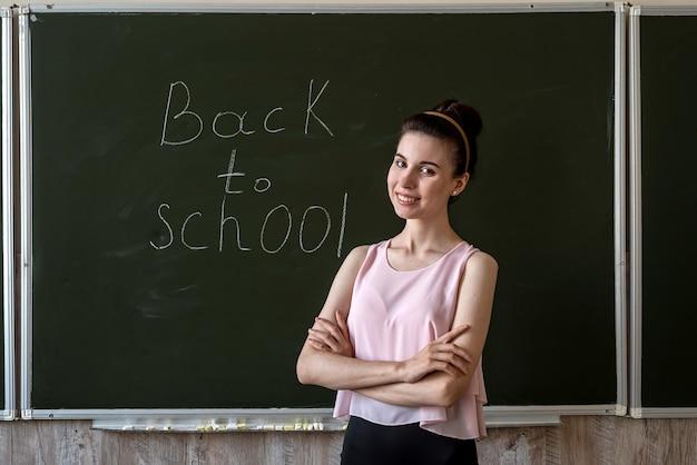 Education concept, back to school written on blackboard, university