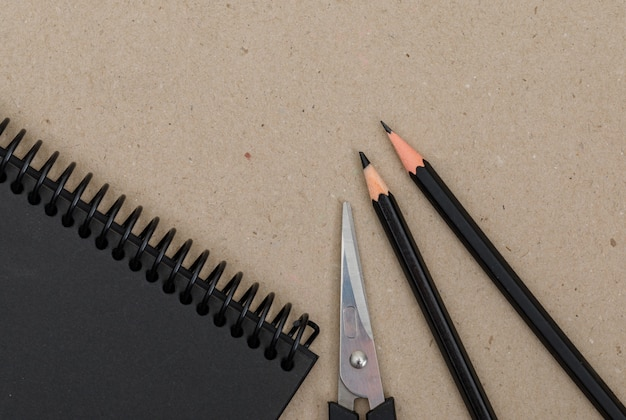Education concept with pencils, scissors, notebook on paper.