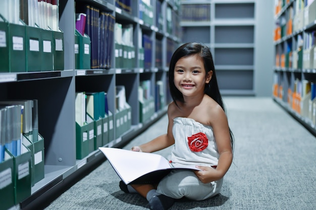 Education concepts. the girl is studying in the library. beautiful girls are happy learning.