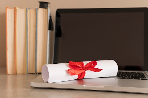 Education diploma certificate on laptop