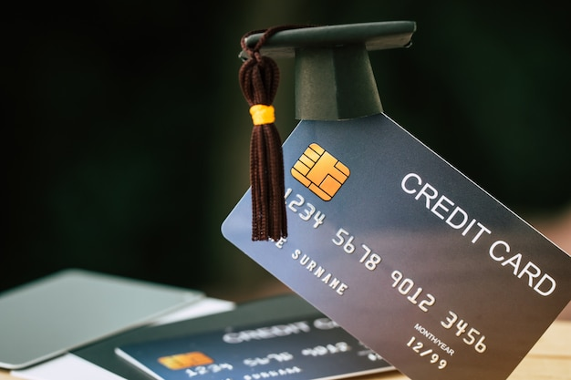 Education payment credit card for study graduate concept: graduation cap on mock up card