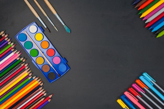 Education school tools on black chalkboard  background