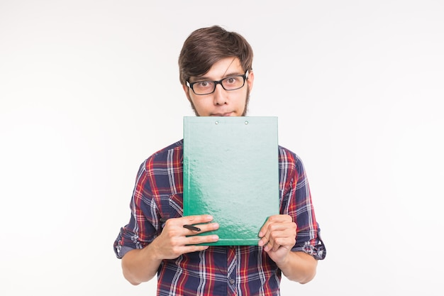 Education, student and business people concept - young man with file and pencil. guy is shy and confused