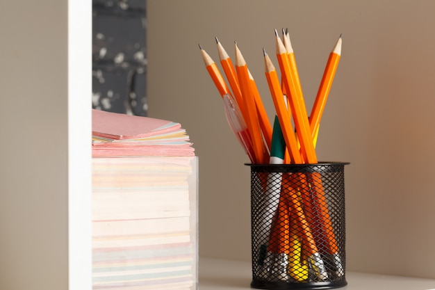 Education, studing and back to school concept creative desk with stationery