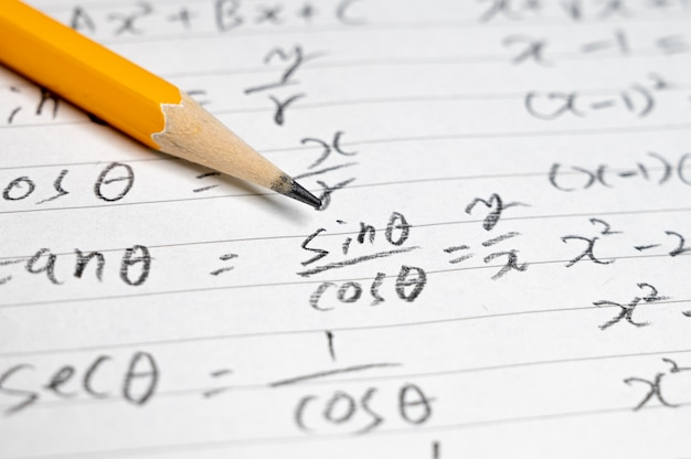 Educational concept background with mathematical formulas and pencils.