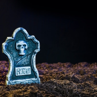 Eerie headstone on soil