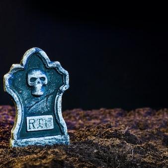 Eerieheadstone on soil