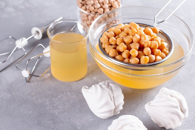Мegan cooking concept, egg replacement , whipped chickpeas water (called aquafaba)