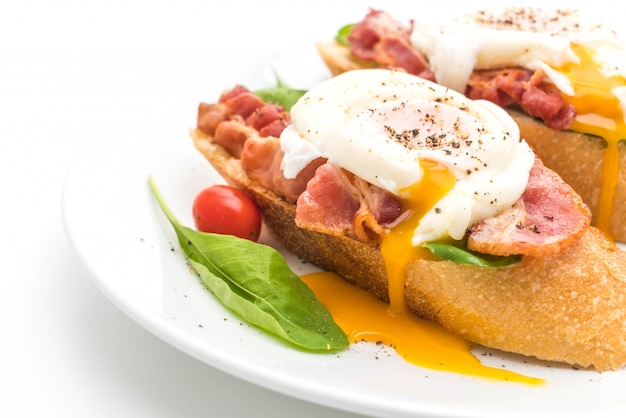 Egg benedict on white background