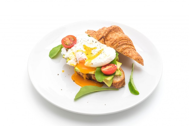 Egg benedict with avocado, tomatoes and salad - healthy or vegan food style