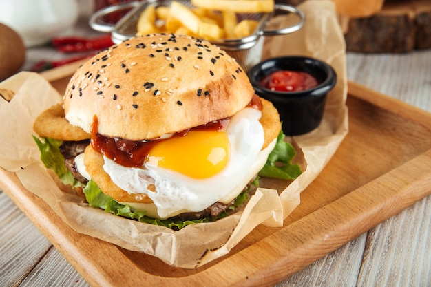 Egg burger combo set with fries and ketchup