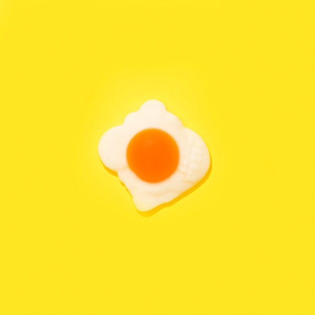 Egg candy on yellow background