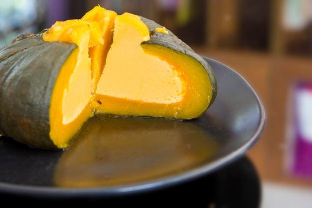Egg custard in pumpkin, pumpkin custard,thai dessert.