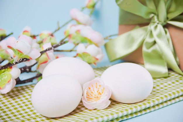 Egg for easter day, gift box and cherry blossom branch