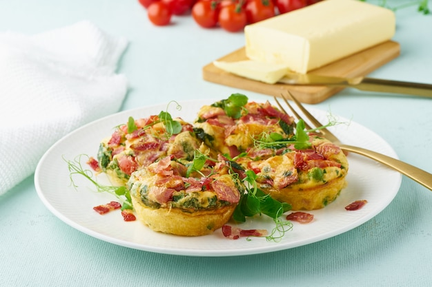 Egg muffin baked with bacon and tomato, ketogenic keto diet, pastel modern closeup