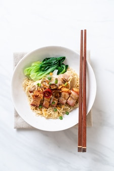 Egg noodle soup with crispy pork belly and wonton